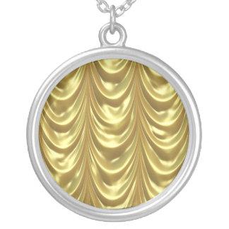 O ouro drapeja bijuterias