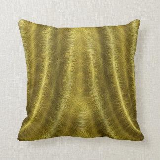 O ouro drapeja o coxim almofada