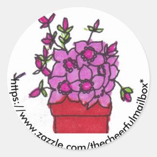 O rosa floresce a etiqueta redonda da caixa postal