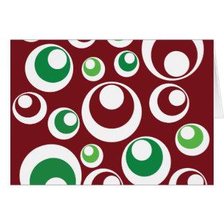 O verde vermelho do Natal festivo circunda o teste Cartão Comemorativo