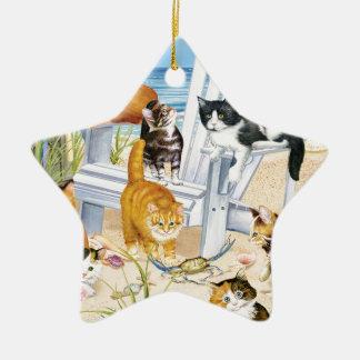 Ornamento da estrela dos gatinhos da praia