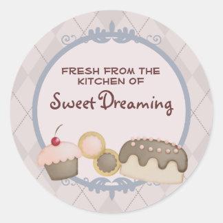 os biscoitos do cupcake do cozimento do padeiro adesivo