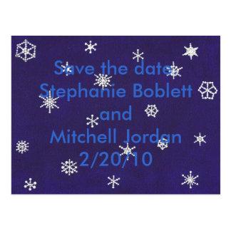 Os flocos de neve no azul salvar a data anúncios cartao postal