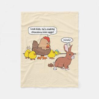 Ovos de chocolate engraçados do coelhinho da cobertor de lã