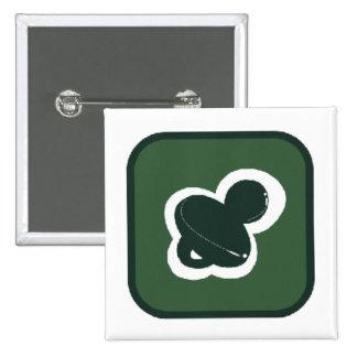 pacifier verde no pino do quadrado da caixa botons