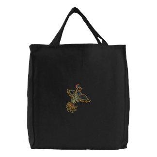 Pássaro exótico bolsas bordadas