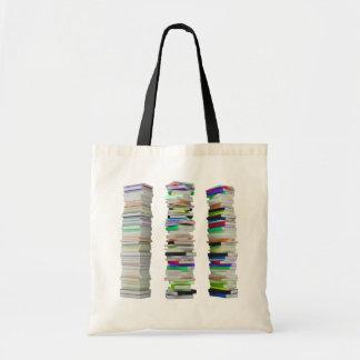 Pilhas de sacola dos livros bolsa tote