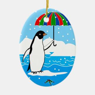 Pinguim na neve em enfeites de natal ovais