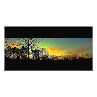 Por do sol calmo da silhueta cartão com foto