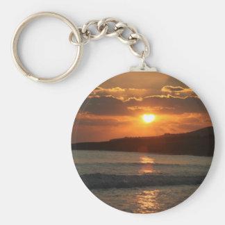 Por do sol na praia da Dinamarca Luz do Praia, o A Chaveiro