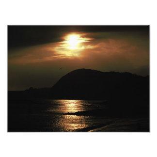 Por do sol sobre Lyme Regis Impressão De Foto