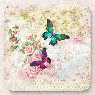 Porta-copos Borboletas cor-de-rosa e verdes em rosas gastos do