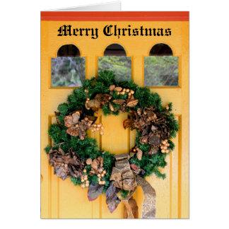 Porta da grinalda do Natal Cartão