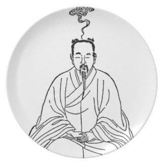 Prato Homem que senta-se na pose da meditação