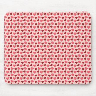Presentes cor-de-rosa e vermelhos do teste padrão  mousepads
