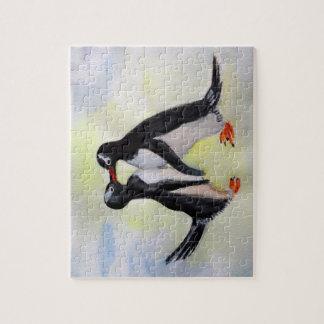 Quebra-cabeça ártico do desenho dos pinguins