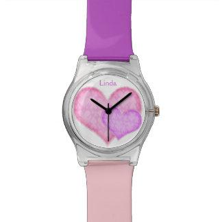 Relógio dos corações cor-de-rosa e roxos
