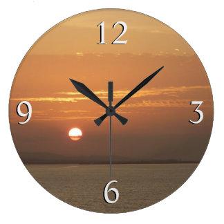 Relógio Grande Nascer do sol sobre Aruba eu caribe o Seascape