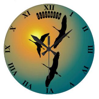 Relógio Grande Três guindastes que voam para a ascensão Sun