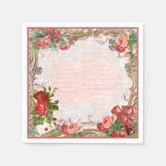 Rosas vermelhas e guardanapo de papel de laço