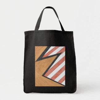 Saco geométrico vermelho e alaranjado do motivo sacola tote de mercado