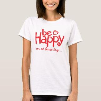 Seja t-shirt tipográfico vermelho feliz do slogan
