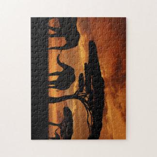 Silhuetas dos elefantes africanos no por do sol quebra-cabeça