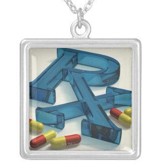 símbolo de 3D RX com cápsulas Pingentes