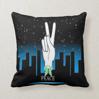 Símbolo de paz com um fundo da cidade almofada