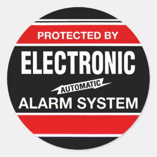 Sistema de alarme eletrônico adesivo