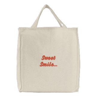 Sorriso doce… bolsas