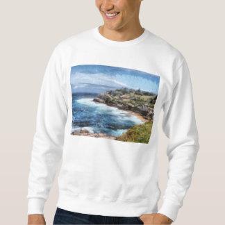 Suéter Angra da água com penhascos rochosos