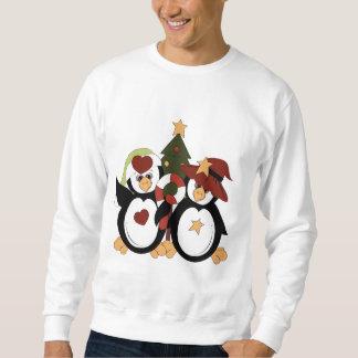 T-shirt dos homens do feriado do pinguim do Natal