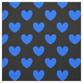 Tecido Corações azuis da polca no preto