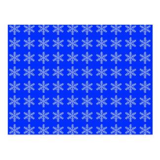 Teste padrão branco do floco de neve com fundo azu cartao postal