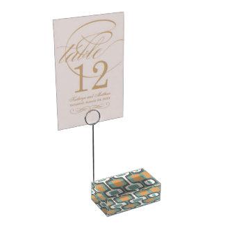 Teste padrão moderno do meio século do pêssego e suporte para cartoes de mesa