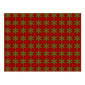Teste padrão verde do floco de neve com fundo verm cartoes postais