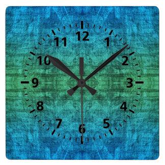 Teste padrão verde e azul da textura do inclinação relógio quadrado