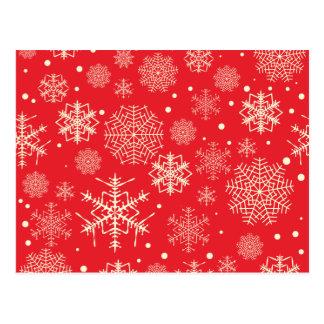Teste padrão vermelho engraçado dos flocos de neve cartão postal