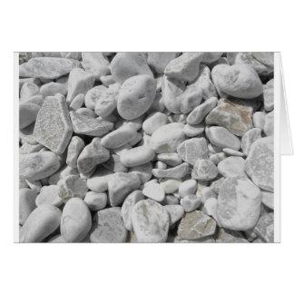 Textura dos seixos de uma costa da praia cartão