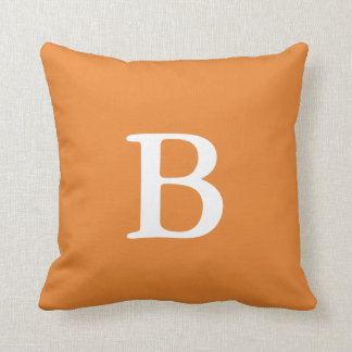 Travesseiro decorativo alaranjado do monograma almofada