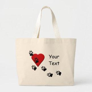 Trilhas da pata do cão em minha sacola do coração bolsa para compras