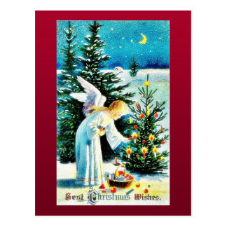 Um cumprimento do Natal com um anjo ajusta o fogo  Cartões Postais