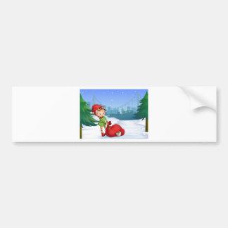 Um duende com um cheio do saco do vermelho dos adesivo para carro