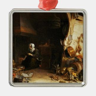 Um interior da cozinha com uma menina de empregado ornamento quadrado cor prata