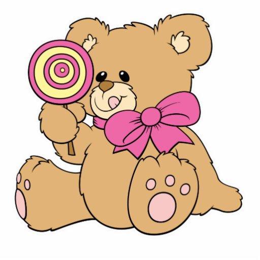 Urso de ursinho bonito do bebê com pirulito escultura foto