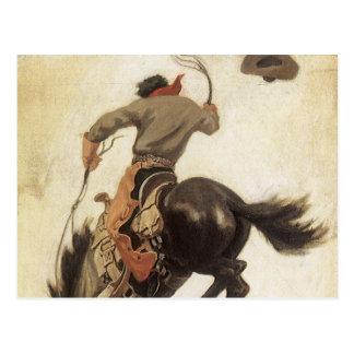 Vaqueiro do vintage em um cavalo Bucking do bronco Cartao Postal