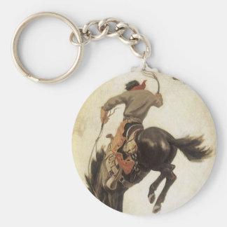 Vaqueiro do vintage em um cavalo Bucking do bronco Chaveiros