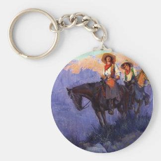 Vaqueiros do vintage, homem e mulher em cavalos, chaveiro