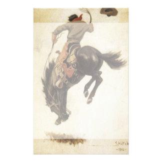 Vintage ocidental, vaqueiro em um cavalo Bucking Papelaria